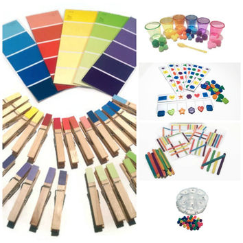 Busy bags kit, matching color with clothes pins and pompom, counting beads, solving problem with popsicle stick and buttons.