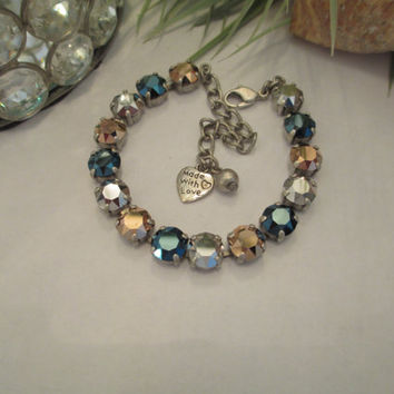 METALLIC SPLENDOR swarovski crystal tennis bracelet. blue, silver, and gold elements #242