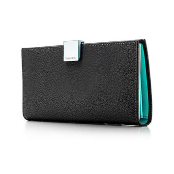 Tiffany & Co. - Continental wallet in onyx textured leather. More colors available.