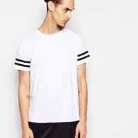 Reclaimed Vintage Longline T-Shirt with Varsity Stripe and PU Hem