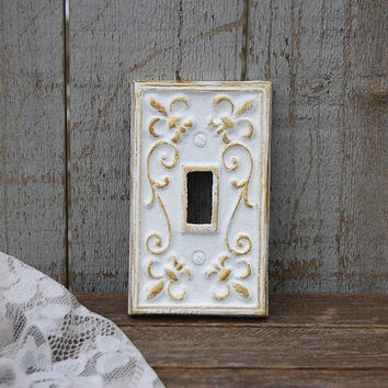 White and gold wall plate