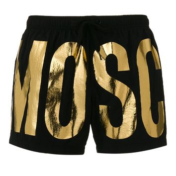 Gold Metallic Black Swim Trunks by Moschino