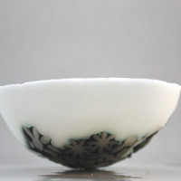 Decorative stoneware English fine bone china small bowl with a unique texture of porcelain flowers.