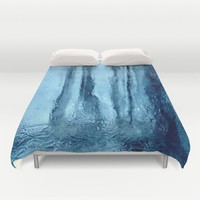 Ice with blue tonnes in a cold winter Duvet Cover by ankka