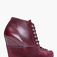 Yves Saint Laurent Oxblood Leather Wedge Boots for women | SSENSE