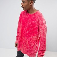 Granted Oversized Sweatshirt In Red With Bleach Effect at asos.com