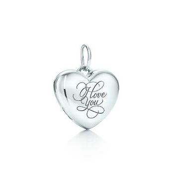 "Tiffany & Co. | Item | ""I Love You"" heart locket in sterling silver, small. 