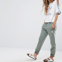 adidas Originals Pastel Camo Sweat Pants In Khaki at asos.com