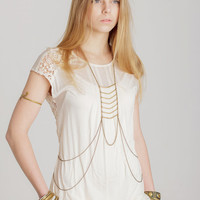 Brass color boho style body chain with ethnic elements