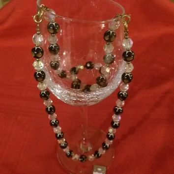 Vintage Necklace, Iridescent, Black and Gold tone beads, approximate length 28 inches
