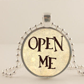 """Alice and Wonderland. Open Me. 1"""" glass and metal Pendant necklace Jewelry."""