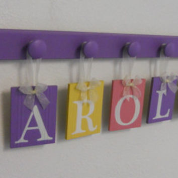 Wooden Letter Baby Girl Nursery Wall Decor Set Includes 8 Wood Hooks and Personalized Name Sign for CAROLINE in Pink, Lilac and Yellow
