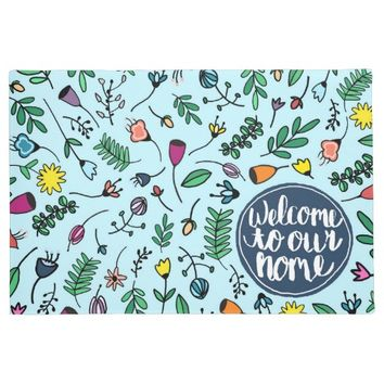 Welcome to our home whimsical floral design doormat