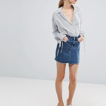 ASOS Denim Deconstructed Skirt With Stepped Hem in Vintage Wash Blue at asos.com