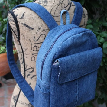 Denim Backpack with Large Front Velcro Pocket, Two Side Pockets, Two Interior Pockets and Lined with a Pink and Blue Floral Cotton 253543384