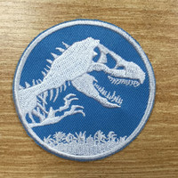 Jurassic world sphere logo embroidery patch with hook and loop velcro backed. 2.5 inches