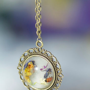 REAL wasp and lady bug preserved in resin with dried flowers on white background with bronze pendant and bronze necklace chain