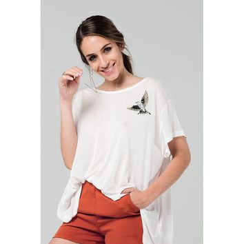 White oversized t-shirt with embroidered detail