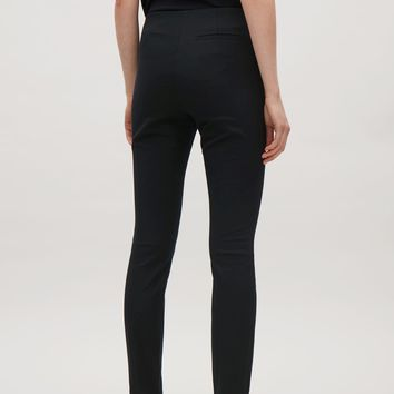 Slim-fit trousers - Black - Trousers - COS FR