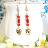 Gold masquerade orange carnelian dangle earrings