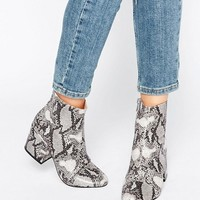 Office Ant Snake Print Heeled Ankle Boots at asos.com