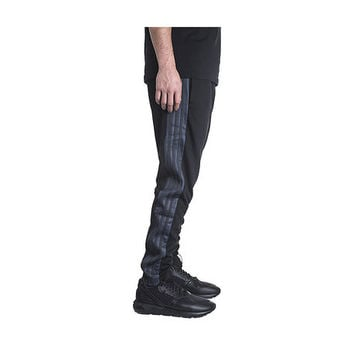 The Tiro 15+ Pants in Black & Grey