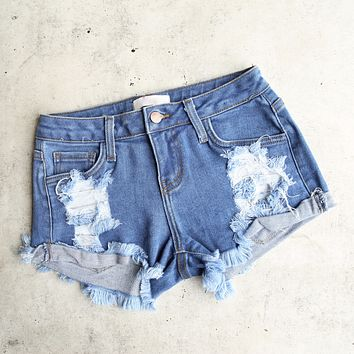 low rise fitted cutoff distressed shorts - mid wash denim