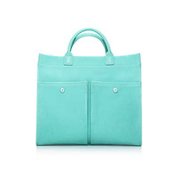 Tiffany & Co. - Jitney tote in Tiffany Blue® canvas and grain leather.