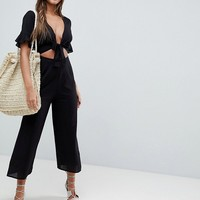ASOS DESIGN tea jumpsuit with cut out and tie detail in linen at asos.com