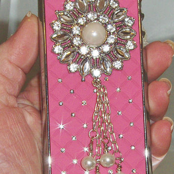 PINK BEDAZZLED CASE. Fits a I phone case 5. Hard case with chris cross pattern with rhinstones.