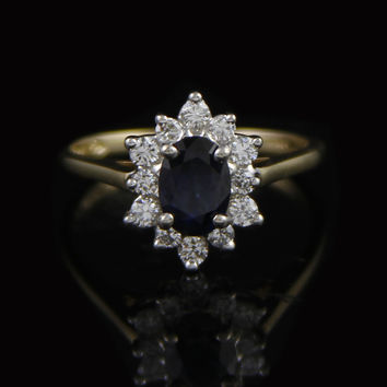 Beautiful Oval Sapphire Ring with Diamond Bezel in 14K Yellow Gold