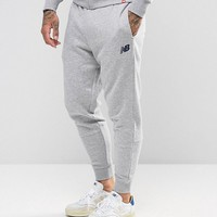 New Balance Essential Joggers In Grey MP73544_AG at asos.com
