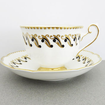 Grosvenor white tea cup and saucer with black and gold swirls and beaded gold border trim - English bone china tea set - Excellent condition