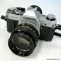 Canon AE-1 SLR 35mm Camera w Canon 50mm 1:1.4 Lens and Strap