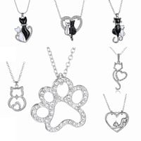 paw necklace and two cats