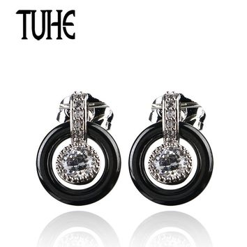 TUHE Women Classic Black White Ceramic Hollow Circle With One Big Crystal Stud Earrings Round Fashion Wedding Jewelry Best Gifts