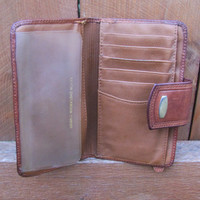 distressed brown leather wallet. distressed leather phone case.  unbranded distressed brown leather wallet.