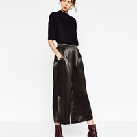 CROPPED TROUSERS WITH SLITS DETAILS
