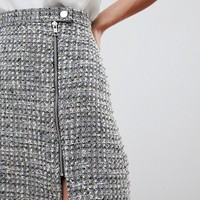 ASOS DESIGN boucle mini skirt with asymmetric zip at asos.com