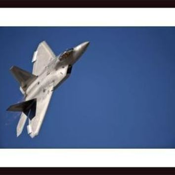 An F-22 Raptor aircraft performs during Aviation Nation 2010., framed black wood, white matte