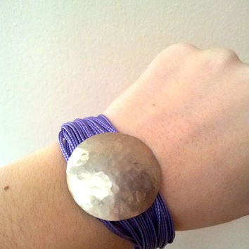 Silky cord bracelet with silver charm