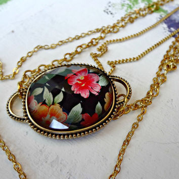 Black Floral Pendant on Three Gold Chains