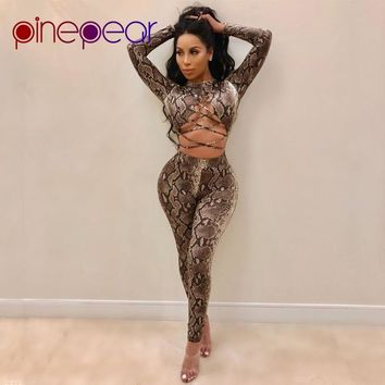 PinePear SnakeSkin Print Jumpsuits 2019 New Winter Long Sleeve Bodycon Bandage Rompers Hollow Out Lace Up Sexy Club Outfits