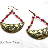 Bronze  and pinkish red  crystal earrings.