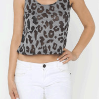 Show your love fashionable in the Forever My Burnout Leopard Boxy Crop Top! This crop style crop top features soft stretch knit, scoop neckline, burnout leopard print throughout, front pocket, and finished with stitching detail. Pair with skinny jeans or h