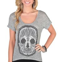 elbow sleeve high low tee with natural crochet skull patch