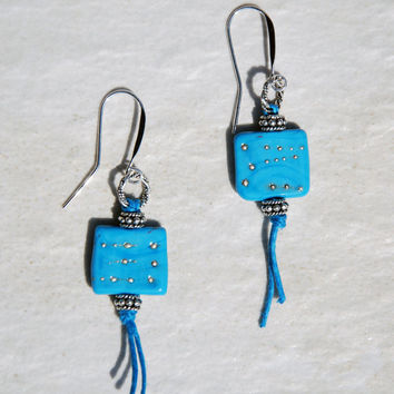 Handmade Blue Unicorne Bead Earrings with Sterling and Bali Silver and hemp cord. Teal blue lampwork glass earrings, blue and silver glass