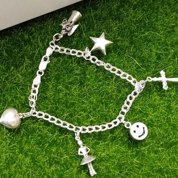 Lovely Sterling Silver Charm bracelet with a  Movable Ballerina, Angel, Cross, Star, Heart and a Smiley Face charms