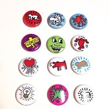 It's a great gift for your friends and families, these famous Keith Haring Pop Art featuring on pins.
