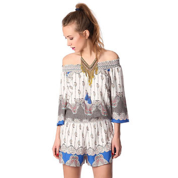 White off the shoulder romper in paisley print
